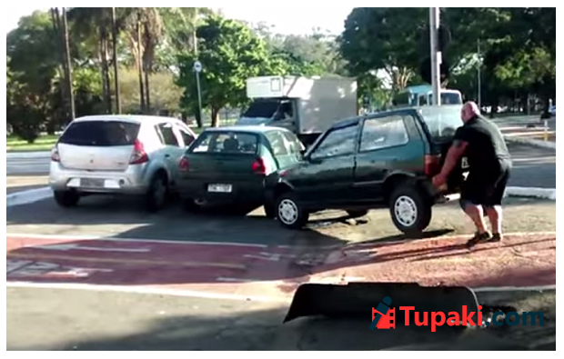 Cyclist lifts car out of bike path with bare hands, rides off