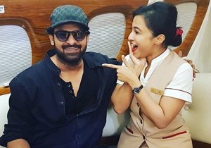 Air Hostess of Emirates Airline had a fan moment With Prabhas