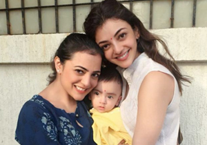 Kajal Agarwal With Her Nephew Photos