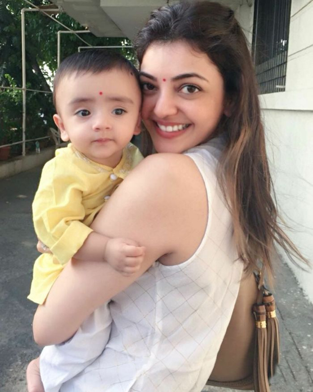 kajal agarwal with her nephew photos photogallery page 1