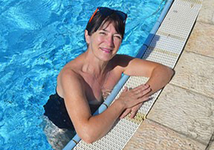 Teacher who was forced to quit over swimsuit photos wins her job