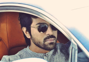 Ram Charan in his swanky Aston Martin car Photos