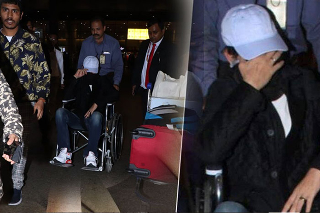 Irrfan Khan spotted in wheelchair, hides his face