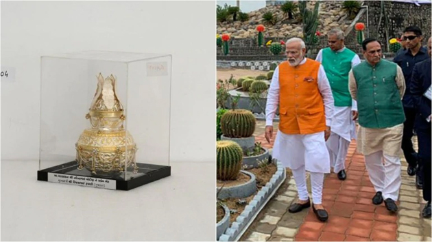 PM Modi photo stand, silver kalash auctioned for Rs 1 crore