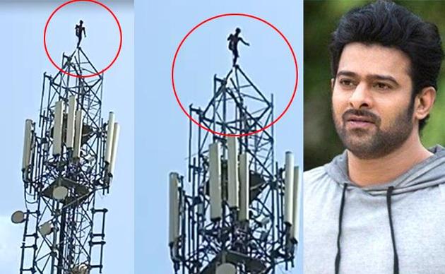 Fan climbs cell tower demanding a talk with Prabhas