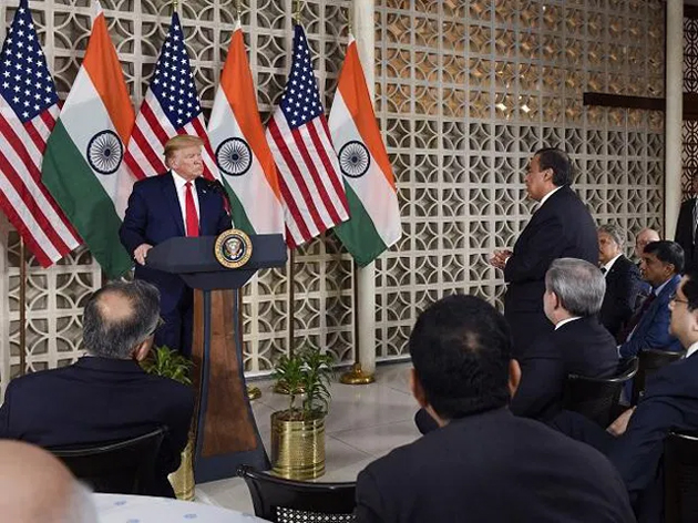 Donald Trump interacts with business leaders in Delhi