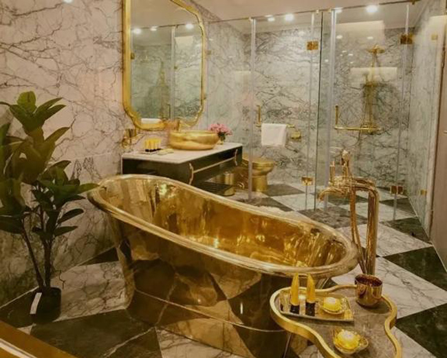 Everything is gold .. Chai cup .. Bathroom .. Sofa .. Bed