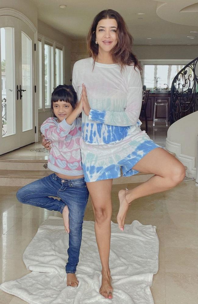 Lakshmi Manchu yoga practice with daughter