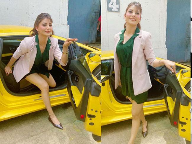 Urvashi gets out of a Lamborghini car