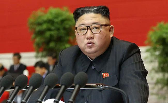 North Korean leader Kim Jong Un has a dark green scar on his head